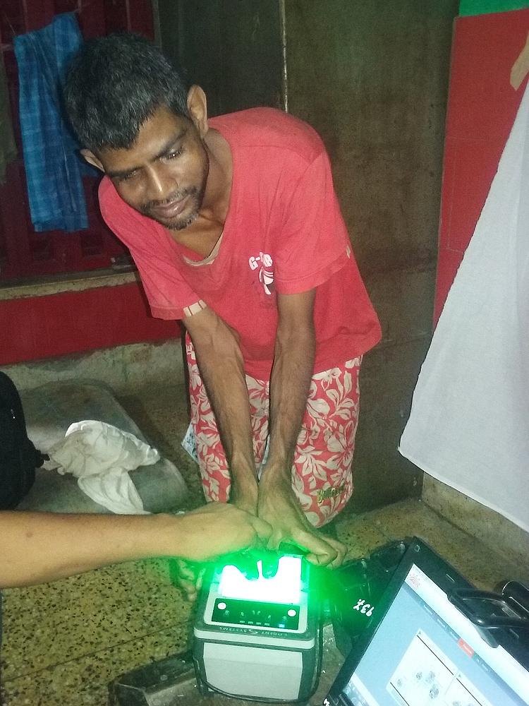 shuktara May 2016 - taking Sunil's fingerprints for aadhaar card