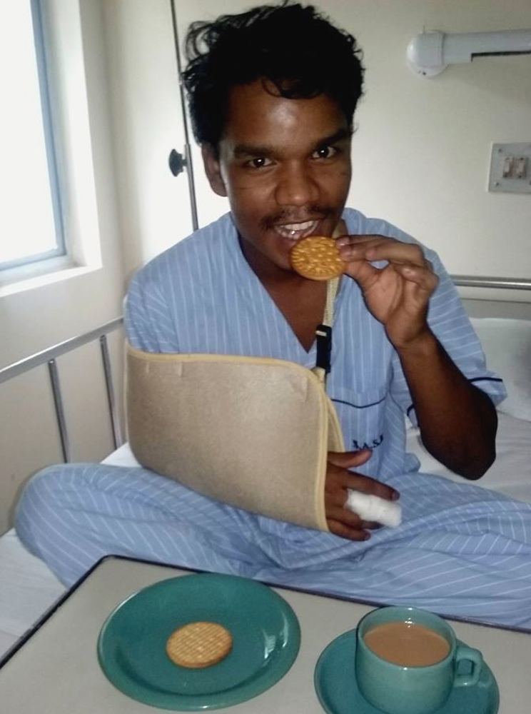 shuktara home for young adults with disability - 2016 August - Rajesh in EDF Hospital eating biscuits