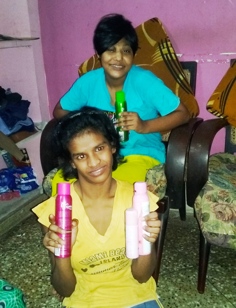 shuktara home for girls with disability - Muniya and Lali with their gifts of perfume