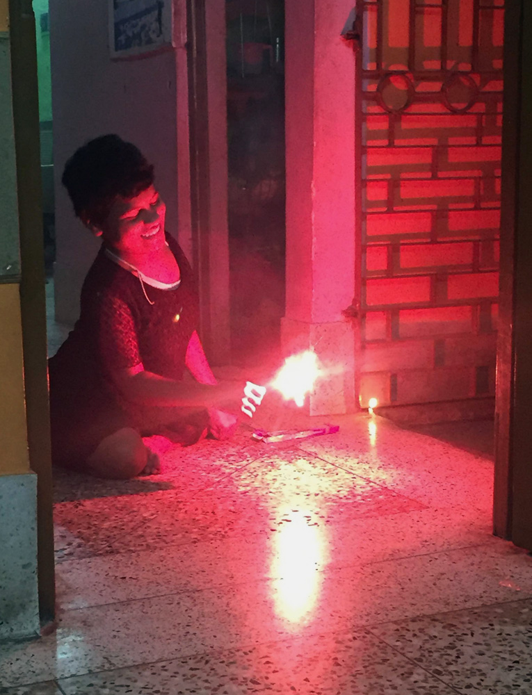 shuktara home for girls with disability - Prity lighting a sparkler