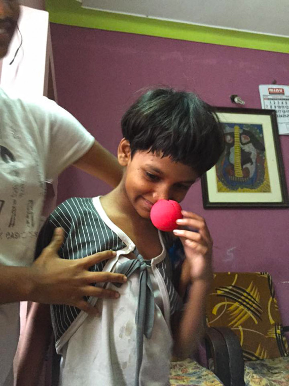 shuktara - Trying on a red nose - February, 2016