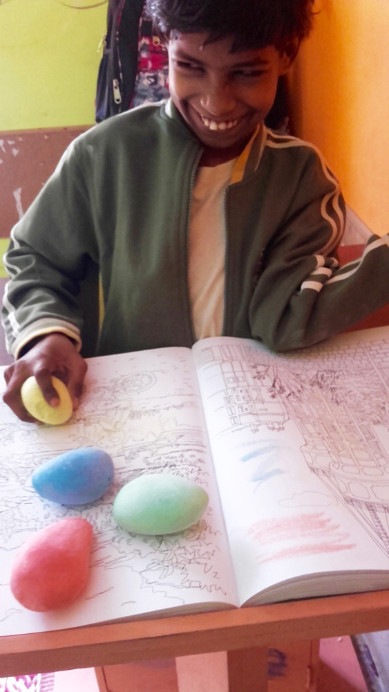 shuktara home for disabled girls - 2017 January - Guria drawing with her coloured chalks