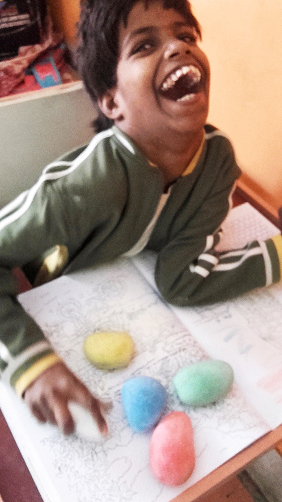 shuktara home for disabled girls - 2017 January - Guria clearly delighted with her new massive coloured chalks