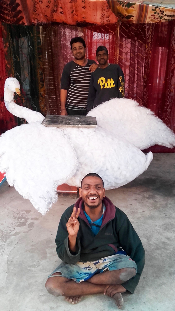 shuktara home for disabled young adults - 2017 January - Pappu, Sunil, Bablu (seated) and the swan - setting up for Saraswati Puja