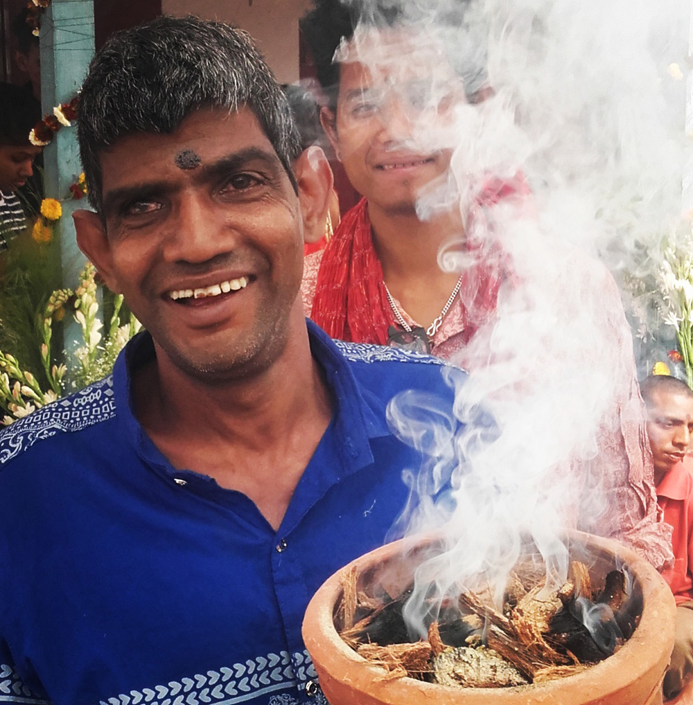 shuktara home for young people with disabilities - 2017 February - Sunil holding the dhuno, with Raja behind the smoke