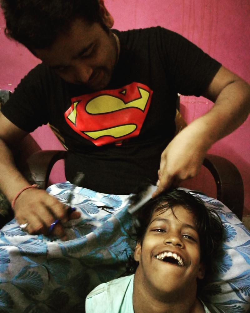 shuktara home for girls with disabilities - 2017 March - Pappu cuts Guria's hair