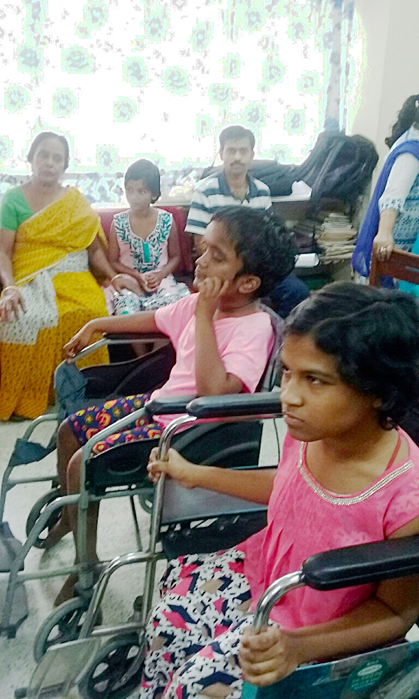 shuktara home for disabled girls - 2017 March - Prity and Moni wait their turn for fingerprinting