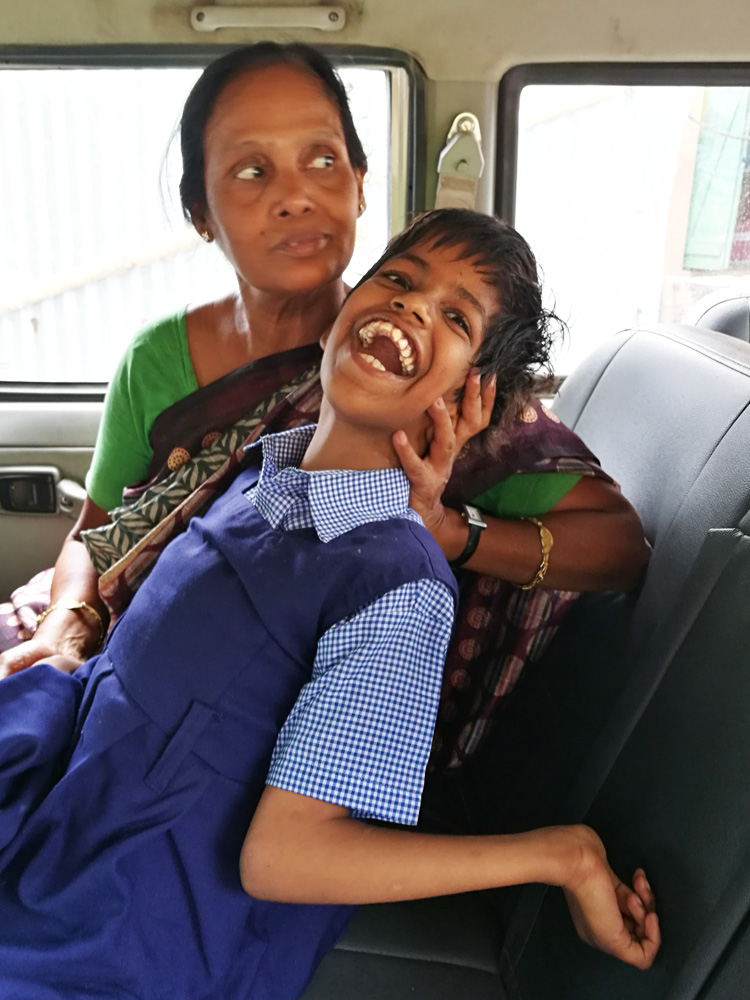 shuktara home for girls with disabilities - 2017 April - Guria with Radha maashi in the car going to REACH
