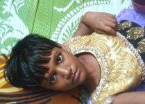 shuktara home for disabled girls - Puja lying on the floor