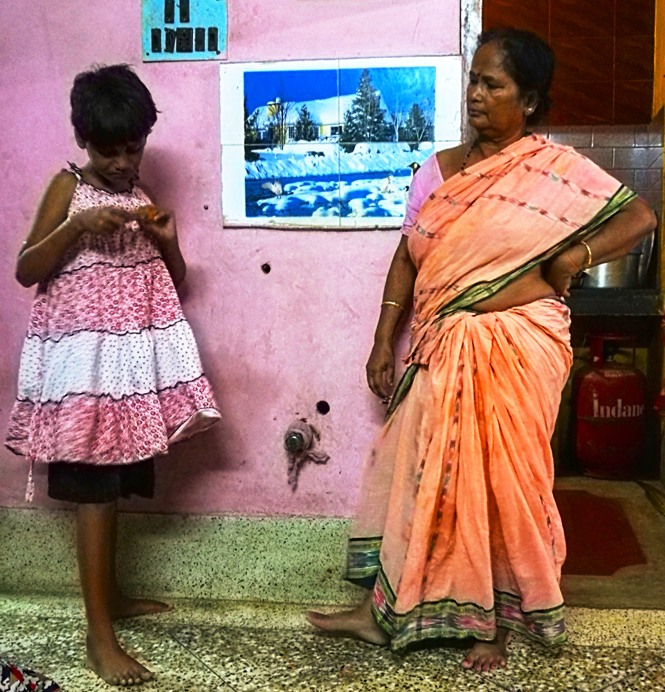 shuktara home for girls with disability - 2017 June - Puja with Maashi looking on at Lula Bari