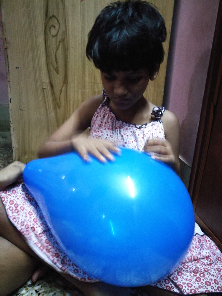 shuktara home for girls with disabilities - 2017 June - Puja with a blue balloon