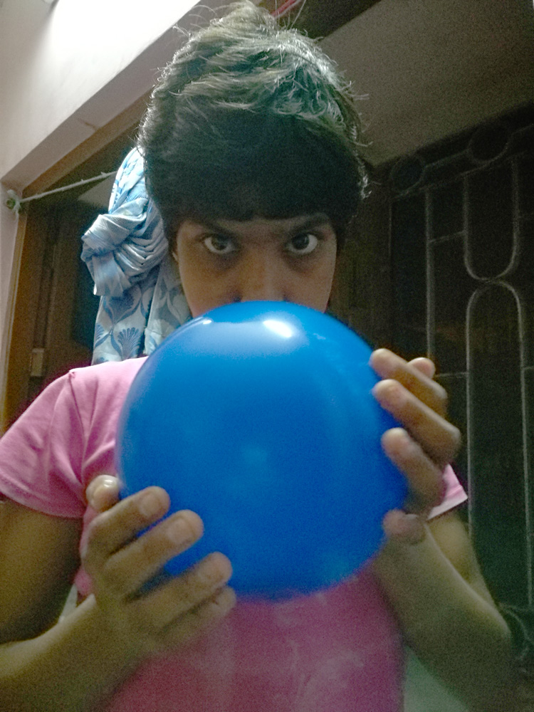 shuktara home for girls with disabilities - 2017 June - Tamina holding a blue balloon