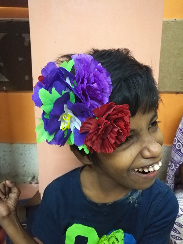 shuktara - 2017 October - Guria wearing paper flowers in her hair