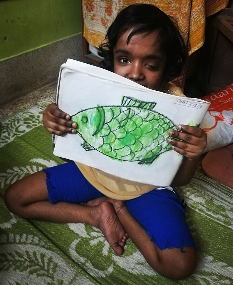 shuktara home for disabled girls - 2018 February - Moni and her fantastic green fish drawing