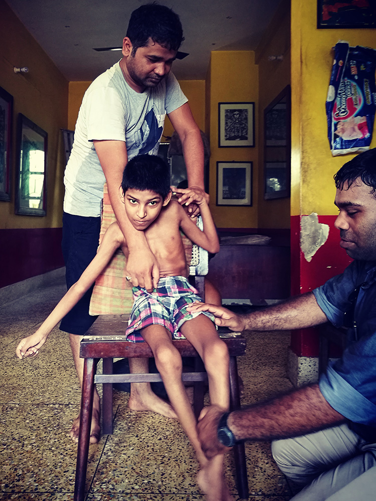 shuktara homes for young people with disabilities - Aakash doing physiotherapy