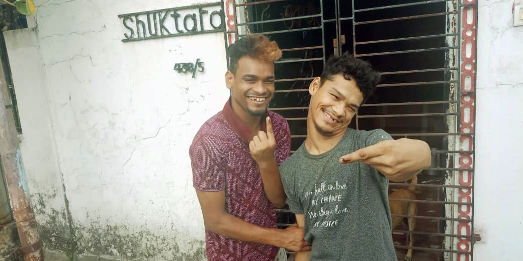 Raju and Ashok from shuktara homes show their inked fingers after voting