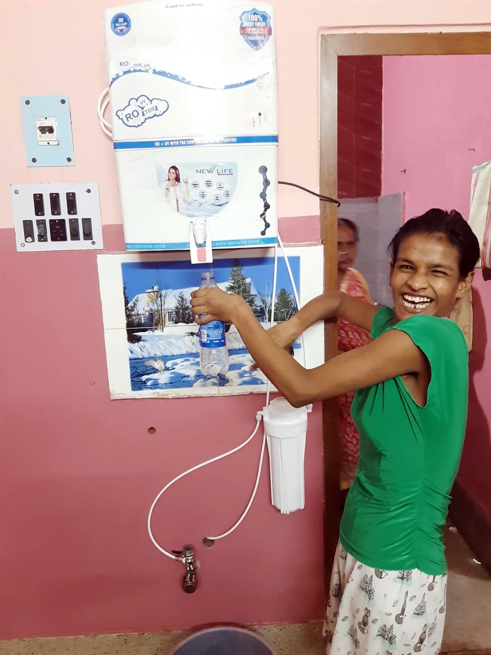 shuktara - Lali with the new water filter at Lula Bari