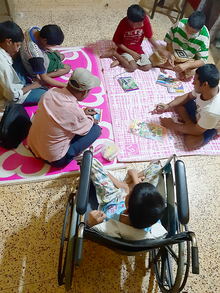 shuktara -  boys learning from Joydeb