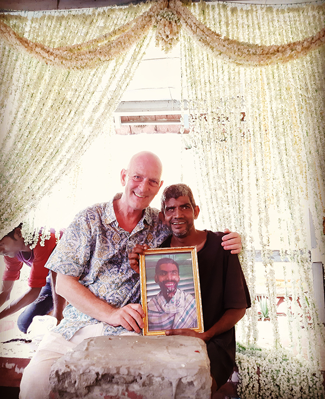 shuktara - David and Sunil holding a photo of Anna