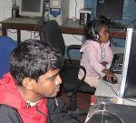 shuktara 2008 - Sunil and Lipika at Uddami on the computer