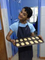 shuktara 2013 - Ashok holding a tray ready for baking, at Shuktara Cakes