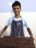 shuktara 2013 - Pinku holding a tray of cakes