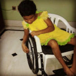 shuktara 2015-10 Prity trying out a wheelchair