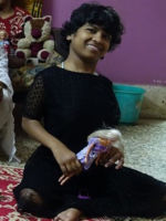 shuktara December 2015 - with her doll from the Netherlands