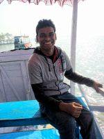 shuktara 2015 - Raju on a boat in the Sundarbans