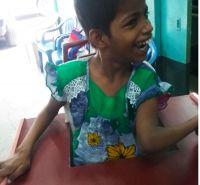 shuktara home for disabled girls - 2016 June - Guria in standing frame, very happy