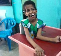 shuktara home for disabled girls - 2016 June - Guria in standing frame smiling