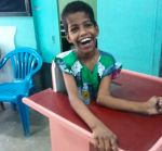 shuktara home for disabled girls - 2016 June - Guria in standing frame smiling
