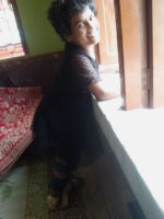 shuktara home for disabled girls - 2016 July - Prity standing by holding on to the window sill