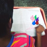shuktara home for disabled girls - 2016 July - Guria drawing with crayons