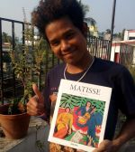 shuktara home for young adults with disability - Raja with a Matisse book
