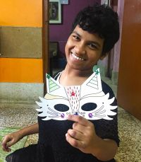 shuktara home for girls with disability - Diwali 2016 Prity holding her mask