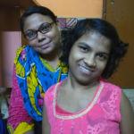 shuktara homes for girls - 2017 June Priyanka sitting behind Prity smiling