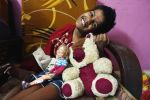shuktara - Guria with her doll and stuffed animal - December 2015