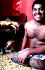 shuktara home for disabled youth - Sumon and dog waiting for dinner