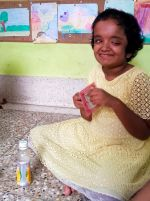 shuktara home for disabled girls - 2016 July - Moni stitching and smiling