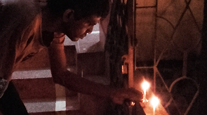 shuktara home for young adults with disabilities - Sunil lights the candles for Kali Puja