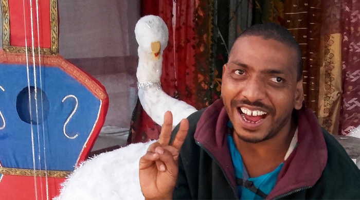 shuktara home for disabled young adults - 2017 January - Bablu and the swan - setting up for Saraswati Puja