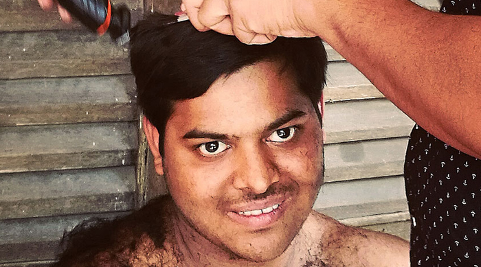 shuktara home for young people with disabilities - 2017 March - Pappu cutting Sumon's hair