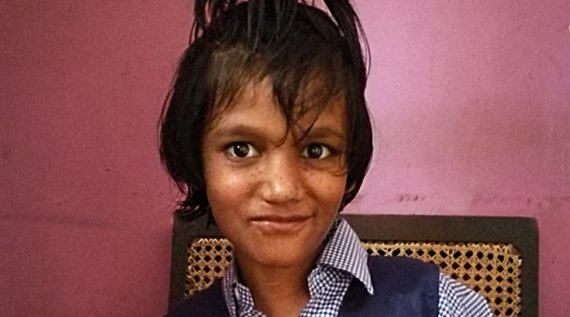 shuktata home for girls with disabilities - 2017 April - Puja in her school uniform - maybe for the first time ever