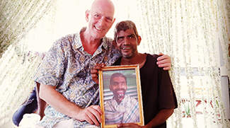 shuktara Founder's Day 2019 - David and Sunil holding a photo of Anna