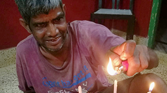 shuktara - Sunil lights the candles on his birthday cake