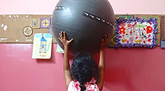 shuktara homes - Moni balancing a ball