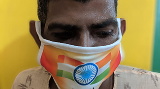 shuktara - Sunil wearing flag mask