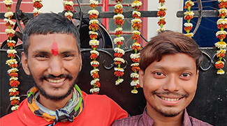 shuktara - boys in front of flowers