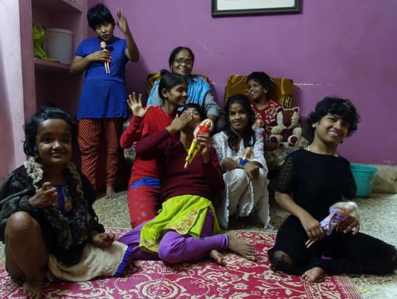Girls at Lula Bari and their repurposed dolls